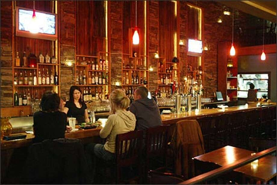 There's no shortage of atmosphere at Mission in West Seattle -- just look at the bar. And the service is friendly, too. Photo: Mike Urban, Seattle Post-Intelligencer / Seattle Post-Intelligencer