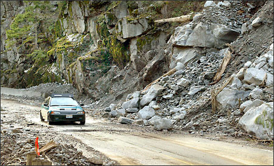 The North Cascades Highway, closed six weeks ago by a rockslide, is opening gradually, allowing access to and from homes for local residents and emergency workers. Photo: Mike Urban, Seattle Post-Intelligencer / Seattle Post-Intelligencer
