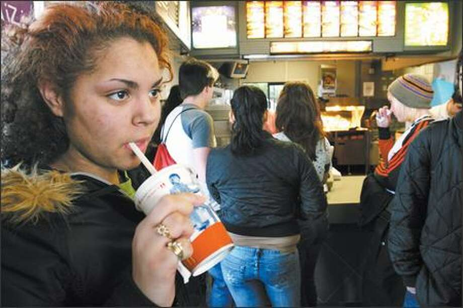 Even though the Seattle School District does not sell sugary sodas in its vending machines, students find other ways to get junk food. In this 2006 photo, Latanya Lucas, 15, goes to a fast-food restaurant near West Seattle High School to get a Sprite at lunchtime. Photo: Meryl Schenker, Seattle Post-Intelligencer / Seattle Post-Intelligencer