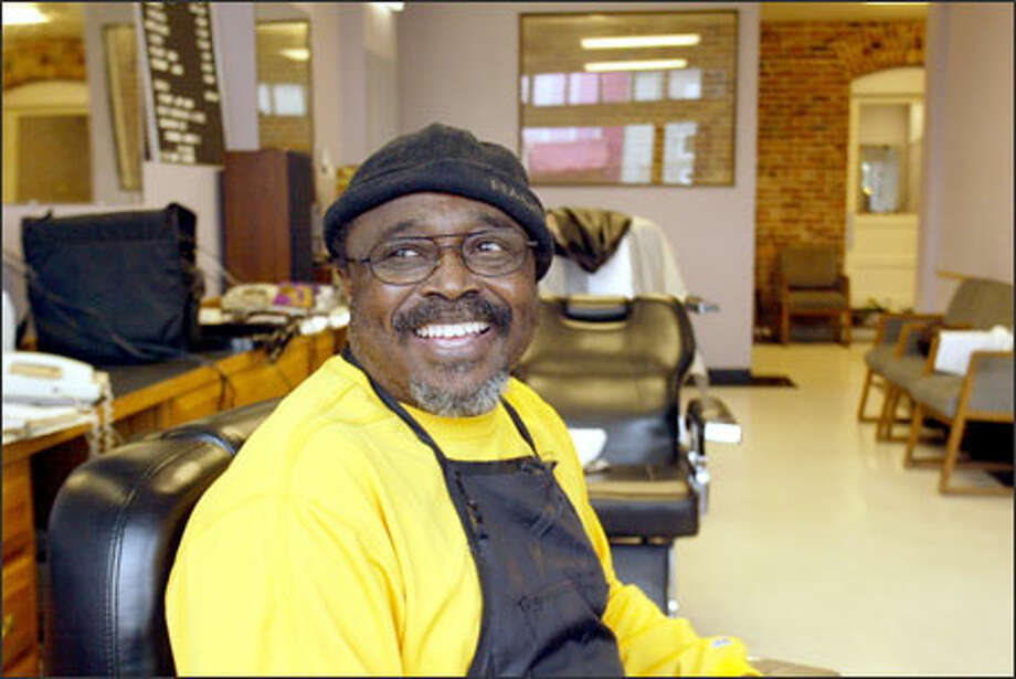 "Stalin Harrison, owner of the former Stalin's Barbershop on King Way, has relocated to Rainier Avenue South and named his shop Showbread. ""It's a bigger place."" Photo: Phil H. Webber, Seattle Post-Intelligencer / Seattle Post-Intelligencer"