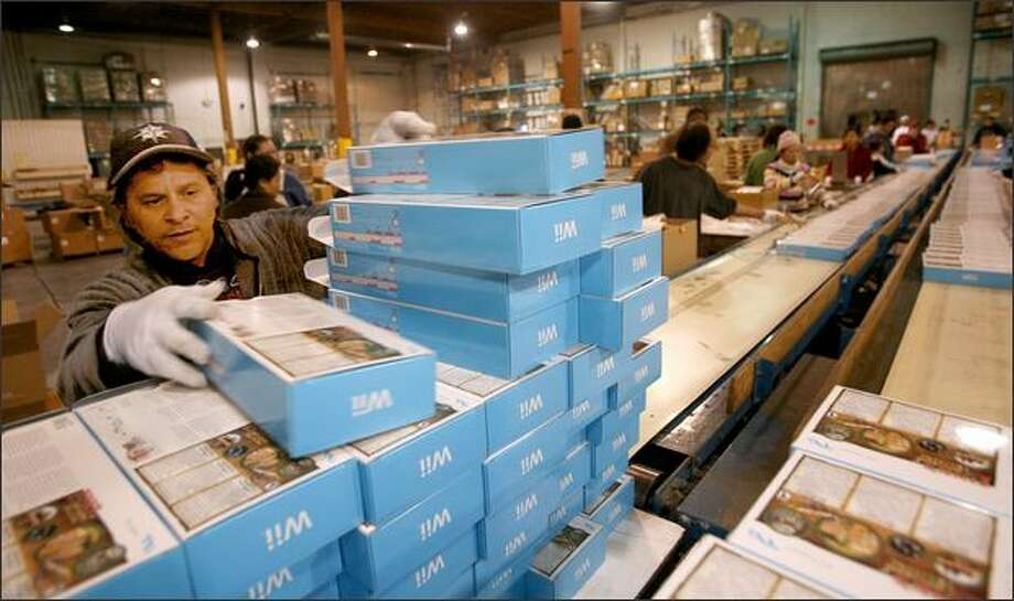 At the end of the line, Fabian Moyett stacks Wii boxes. Pioneer Human Services offers not only employment, but also counseling, drug treatment programs, housing, work release and job training. Photo: Scott Eklund, Seattle Post-Intelligencer / Seattle Post-Intelligencer