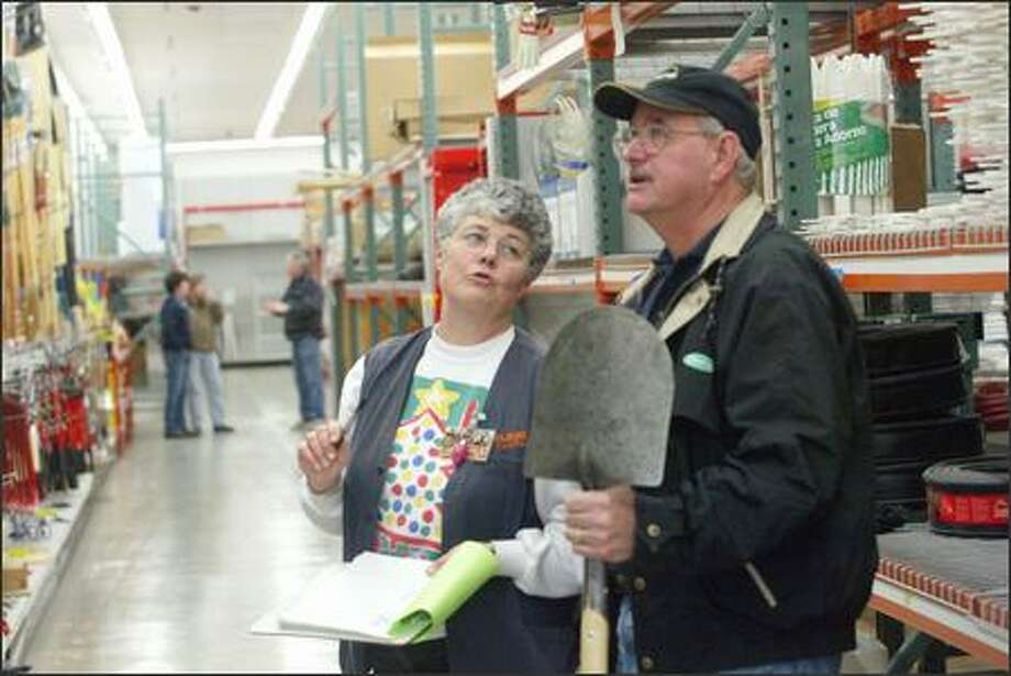 Sales rep Helen Burch chats with buyer Warren Hardrock during setup of McLendon's new Renton location, a 110,000-square-foot store. Photo: Phil H. Webber, Seattle Post-Intelligencer / Seattle Post-Intelligencer