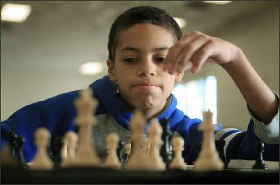 Seventh-grader John Kyllo, 12, concentrates on his next move during a meeting of the Chess Club at Seattle Public Schools' Homeschool Resource Center on Tuesday. Photo: Dan DeLong, Seattle Post-Intelligencer / Seattle Post-Intelligencer