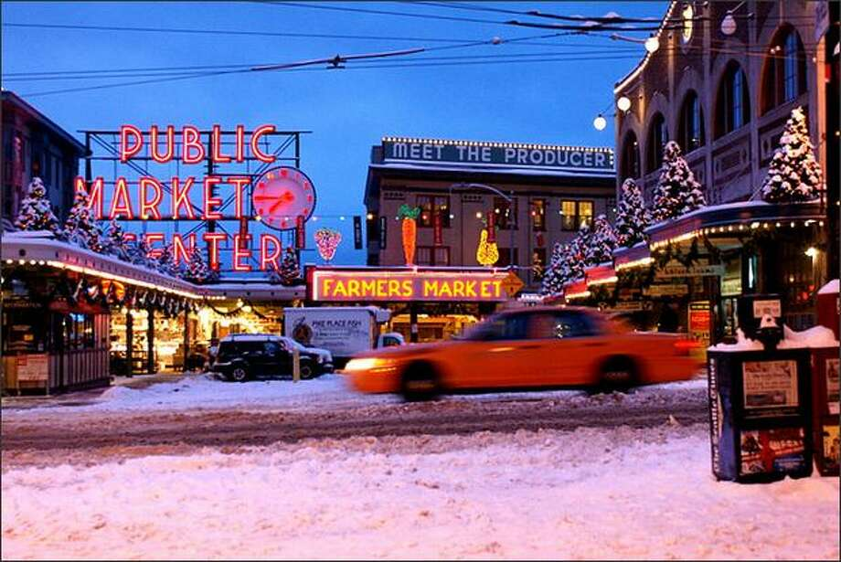 Snow covers the Pike Place Market early Sunday morning. (Photo by MySeattlePix contributor tom787)
