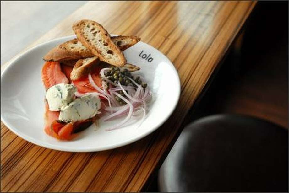 Lola's offers a plate of house-cured gravlax with capers, chive cream cheese, and ficelle. Photo: Steve Shelton, Special To The Seattle Post-Intelligencer / Special to the Seattle Post-Intelligencer