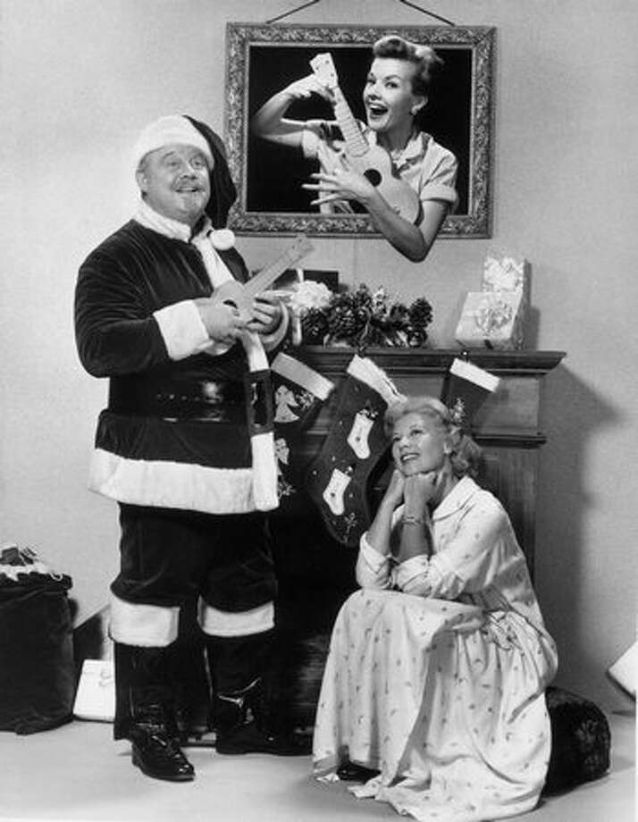 Burl Ives (left) poses with American singer and actress Dinah Shore  and actress Gale Storm in this promotional image for a Dinah Shore Christmas television special, taken about 1955. Photo: Getty Images / Getty Images