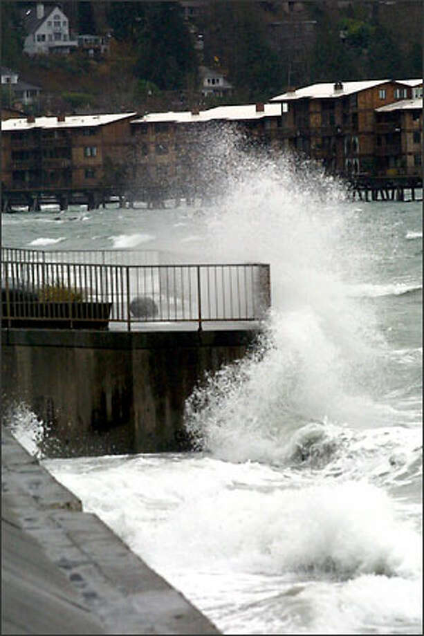 Waves from a windstorm that blew though Seattle on Christmas Day pound the sea wall along Beach Drive Southwest. Gusty winds may return Friday. Photo: Phil H. Webber, Seattle Post-Intelligencer / Seattle Post-Intelligencer