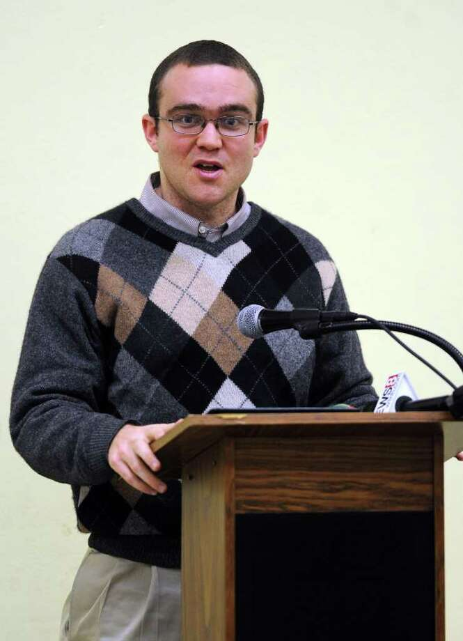 Bo Chamberlin, Field Organizer for the Connecticut Network to Abolish the Death Penalty, introduces Bud Welch, whose daughter, Julie, died in the Oaklahoma City bombing, during a speaking engagement at St. Gabriel Church Hall in Milford on Tuesday, April 5, 2011. Photo: Lindsay Niegelberg / Connecticut Post