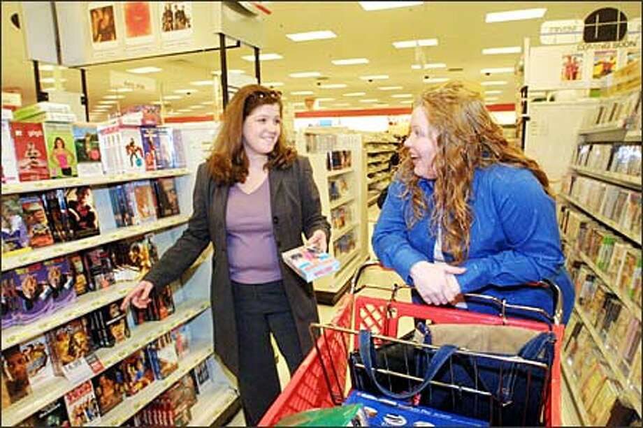 Tiah Pate and Niki Lauby do some Christmas shopping at the Target store at Westfield Shoppingtown Southcenter this week. Retailers must open consumers' wallets. Photo: Phil H. Webber, Seattle Post-Intelligencer / Seattle Post-Intelligencer