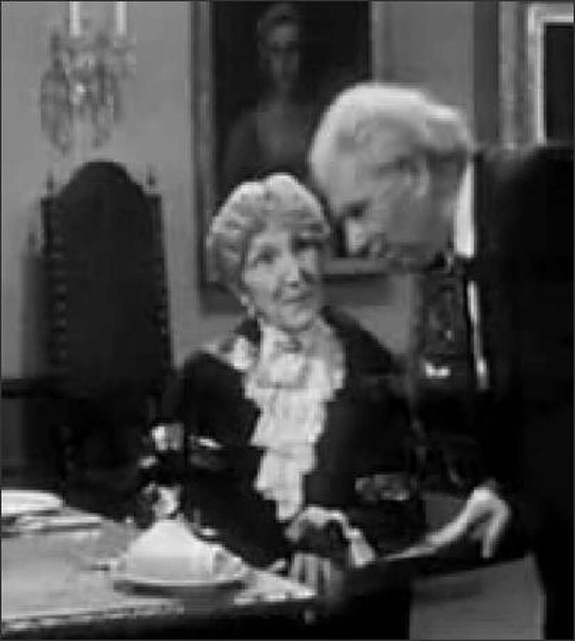 "Miss Sophie (May Warden) and the put-upon butler James (Freddie Frinton) in the 11-minute 1963 skit ""Dinner for One."""
