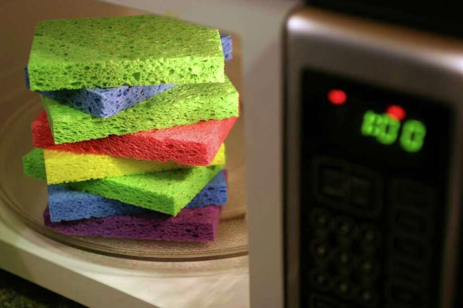 A sponge holds more bacteria than any other item in the kitchen. But here's a quick tip: Microwaving damp ones for a minute has been found to be one of the best ways to nearly eliminate the bacteria, yeast and molds that can inhabit them. The Associated Press Photo: LARRY CROWE, STR / AP2007
