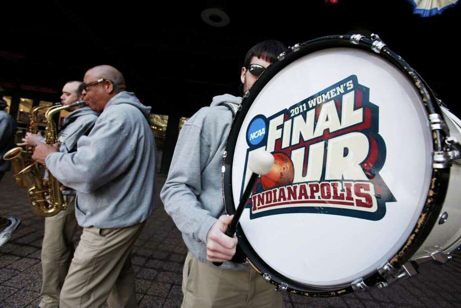 Musicians entertain fans arriving at Conseco Fieldhouse for the women's NCAA Final Four college basketball championship game between Texas A&M and Notre Dame in Indianapolis, Tuesday, April 5, 2011. (AP Photo/Amy Sancetta) Photo: Amy Sancetta, STF / AP