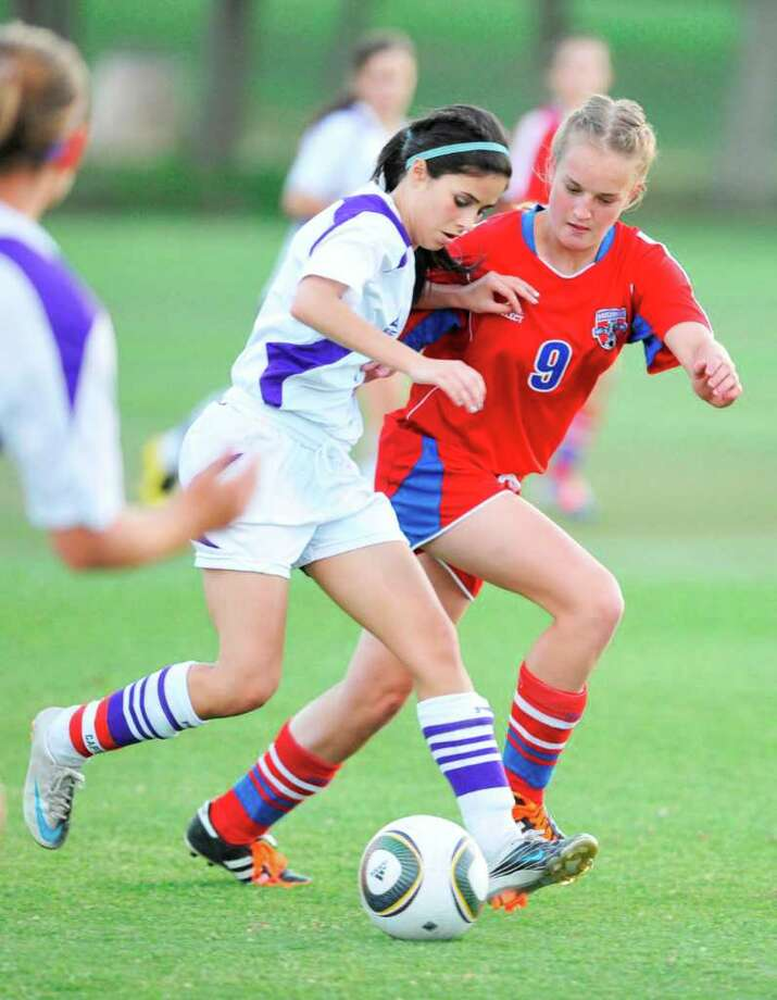PN-G's Natalie Hager, left, dribbles against Waco Midway defender Megan Murphy in the second half of their regional quarter final match at Hohlt Park in Brenham, April 5, 2011.  Valentino Mauricio/The Enterprise Photo: Valentino Mauricio / Beaumont