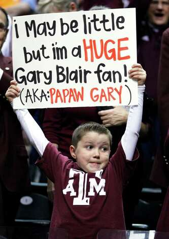 Logan Burch, 7, son of Texas A&M head coach Gary Blair, holds up a sign before the women's NCAA Final Four college basketball championship game against Notre Dame in Indianapolis, Tuesday, April 5, 2011. Photo: AP