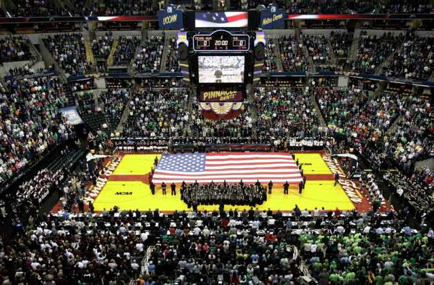 The American flag is held on the court during the national anthem before the women's NCAA Final Four college basketball championship game between Notre Dame and Texas A&M in Indianapolis, Tuesday, April 5, 2011. Photo: AP