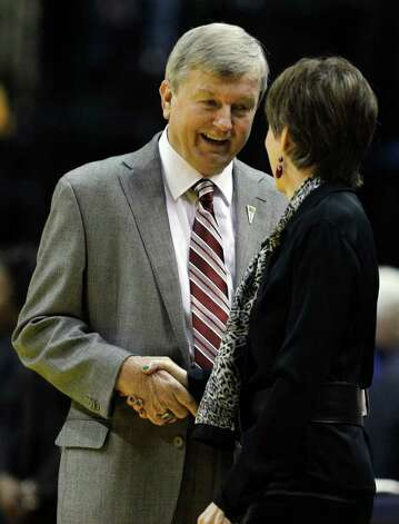 Texas A&M head coach Gary Blair greets Notre Dame head coach Muffet McGraw before women's NCAA Final Four college basketball championship game in Indianapolis, Tuesday, April 5, 2011. Photo: AP