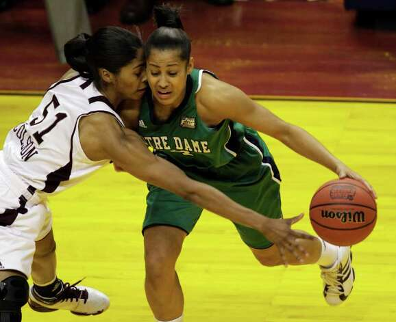 Notre Dame's Skylar Diggins (4) tries to drive around Texas A&M's Sydney Colson (51) in the first half of the women's NCAA Final Four college basketball championship game in Indianapolis, Tuesday, April 5, 2011. Photo: AP