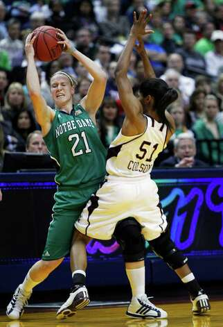 Notre Dame's Natalie Novosel (21) is defended by Texas A&M's Sydney Colson (51) in the first half of the women's NCAA Final Four college basketball championship game in Indianapolis, Tuesday, April 5, 2011. Novosel was called for an offensive foul on the play. Photo: AP