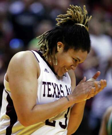 Texas A&M's Danielle Adams (23) reacts to a play against Notre Dame in the first half of the women's NCAA Final Four college basketball championship game in Indianapolis, Tuesday, April 5, 2011. Photo: AP