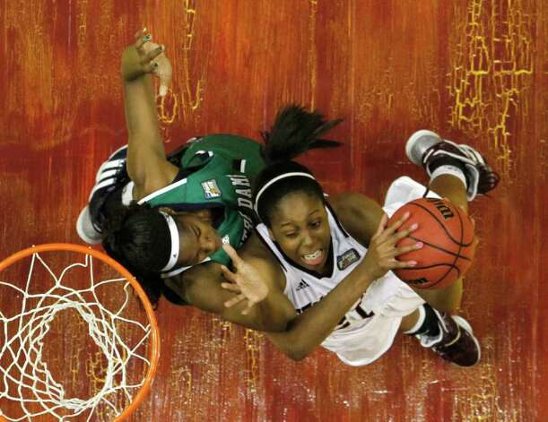 Texas A&M's Adaora Elonu, right, puts up a shot under pressure form Notre Dame's Devereaux Peters in the first half of the women's NCAA Final Four college basketball championship game in Indianapolis, Tuesday, April 5, 2011. Photo: AP