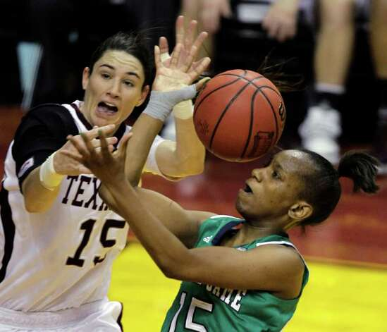 Notre Dame's Kaila Turner, right, has a shot blocked Texas A&M's Maryann Baker (15)  in the first half of the women's NCAA Final Four college basketball championship game in Indianapolis, Tuesday, April 5, 2011. Photo: AP
