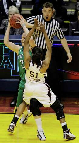 Texas A&M's Sydney Colson (51) falls back after an offensive foul by Notre Dame's Brittany Mallory in the first half of the women's NCAA Final Four college basketball championship game in Indianapolis, Tuesday, April 5, 2011. Photo: AP
