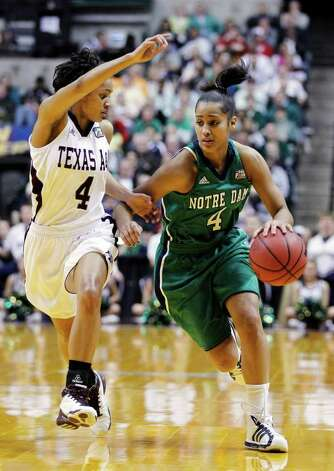 Notre Dame's Skylar Diggins, right, drives to the basket against Texas A&M's Sydney Carter in the first half of the women's NCAA Final Four college basketball championship game in Indianapolis, Tuesday, April 5, 2011. Photo: AP