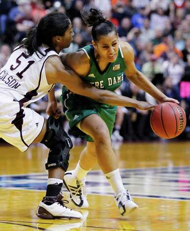Notre Dame's Skylar Diggins, right, tries to work around Texas A&M's Sydney Colson (51) in the first half of the women's NCAA Final Four college basketball championship game in Indianapolis, Tuesday, April 5, 2011. Photo: AP