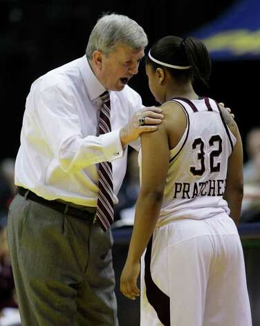 Texas A&M head coach Gary Blair talks with Adrienne Pratcher (32) during a break in the first half of the women's NCAA Final Four college basketball championship game against Notre Dame in Indianapolis, Tuesday, April 5, 2011. Photo: AP
