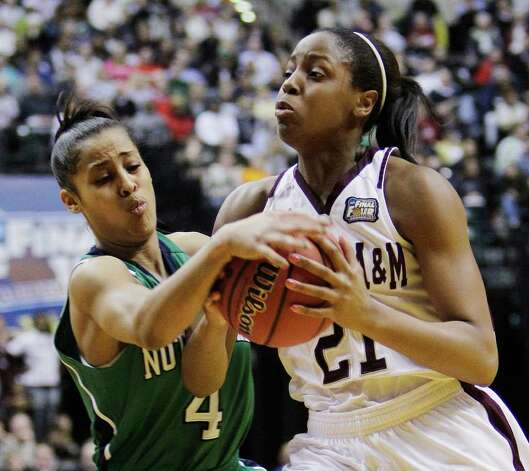 Notre Dame's Skylar Diggins (4) tries to strip the ball from Texas A&M's Adaora Elonu (21) in the first half of the women's NCAA Final Four college basketball championship game in Indianapolis, Tuesday, April 5, 2011. Photo: AP