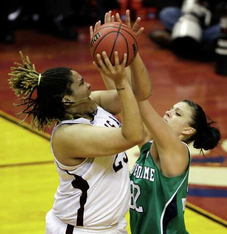Texas A&M's Danielle Adams, left, shoots over Notre Dame's Becca Bruszewski in the first half of the women's NCAA Final Four college basketball championship game in Indianapolis, Tuesday, April 5, 2011. Photo: AP