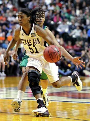 Texas A&M's Sydney Colson (51) drives to the basket as Notre Dame's Skylar Diggins (4) defends from behind in the second half of the women's NCAA Final Four college basketball championship game in Indianapolis, Tuesday, April 5, 2011. Photo: AP