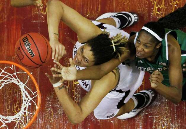 Texas A&M's Danielle Adams, left, and Notre Dame's Devereaux Peters go for a rebound in the second half of the women's NCAA Final Four college basketball championship game in Indianapolis, Tuesday, April 5, 2011. Photo: AP