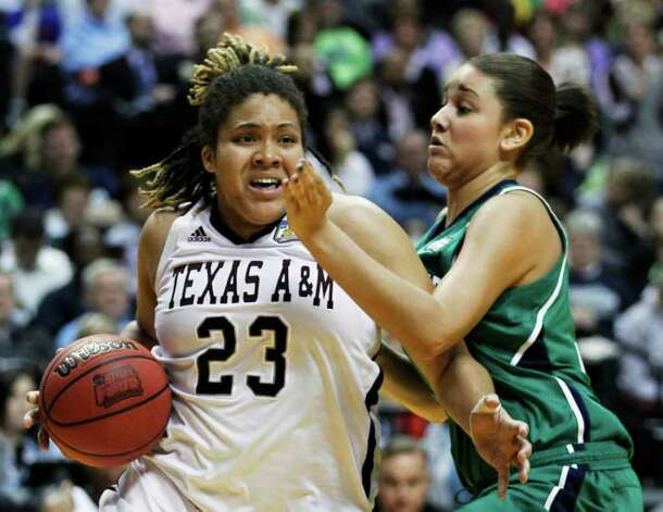 Texas A&M's Danielle Adams (23) is defended closely by Notre Dame's Natalie Achonwa in the second half of the women's NCAA Final Four college basketball championship game in Indianapolis, Tuesday, April 5, 2011. Photo: AP
