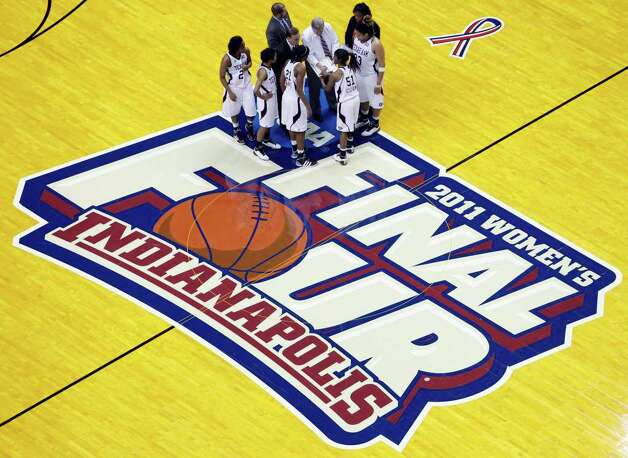 Texas A&M players and coaches huddle at center court during a break in the second half of the women's NCAA Final Four college basketball championship game against Notre Dame in Indianapolis, Tuesday, April 5, 2011. Photo: AP