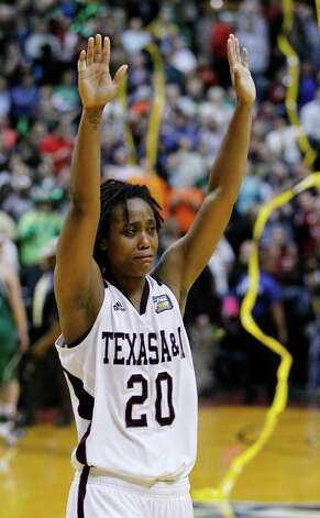 Texas A&M's Tyra White celebrates after Texas A&M's 76-70 win over Notre Dame in the women's NCAA Final Four college basketball championship game in Indianapolis, Tuesday, April 5, 2011. Photo: AP