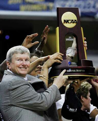 Texas A&M head coach Gary Blair celebrates with the trophy after Texas A&M's 76-70 win over Notre Dame in the women's NCAA Final Four college basketball championship game in Indianapolis, Tuesday, April 5, 2011. Photo: AP