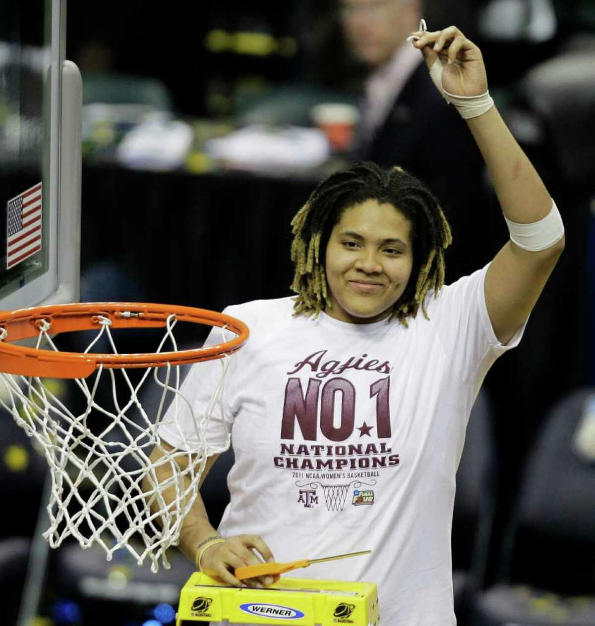 Texas A&M's Danielle Adams holds a piece of the net after Texas A&M's 76-70 win over Notre Dame in the women's NCAA Final Four college basketball championship game in Indianapolis, Tuesday, April 5, 2011.