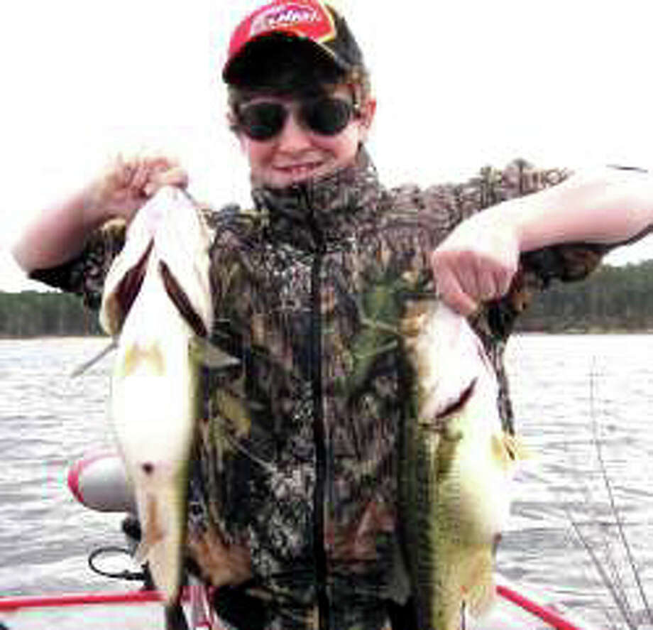 Young angler Landon Weeks of Pineville, LA with a pair of big bass.