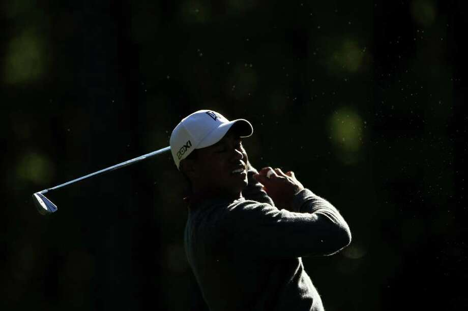 AUGUSTA, GA - APRIL 06:  Tiger Woods hits a shot during a practice round prior to the 2011 Masters Tournament at Augusta National Golf Club on April 6, 2011 in Augusta, Georgia.  (Photo by Jamie Squire/Getty Images) *** Local Caption *** Tiger Woods Photo: Jamie Squire, Getty Images / 2011 Getty Images