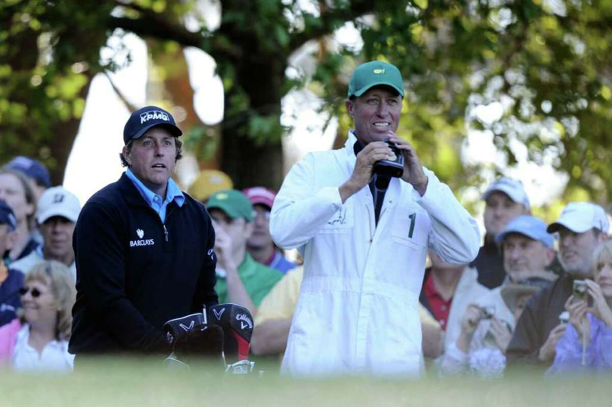 AUGUSTA, GA - APRIL 06: Phil Mickelson waits on a tee box with his caddie Jim Mackay during a practice round prior to the 2011 Masters Tournament at Augusta National Golf Club on April 6, 2011 in Augusta, Georgia. (Photo by Harry How/Getty Images) *** Local Caption *** Phil Mickelson;Jim Mackay