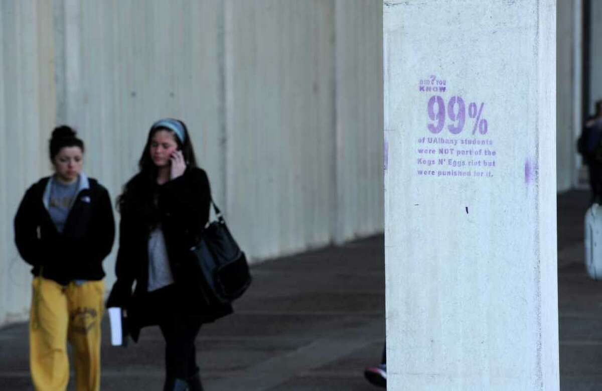 A large number of columns on the main level of Academic Podium of the University at Albany, N.Y. were stenciled with an inscription stating that 99% of the student body was not responsible for the Kegs and Eggs riots overnight and was discovered this morning April 6, 2011. (Skip Dickstein / Times Union)