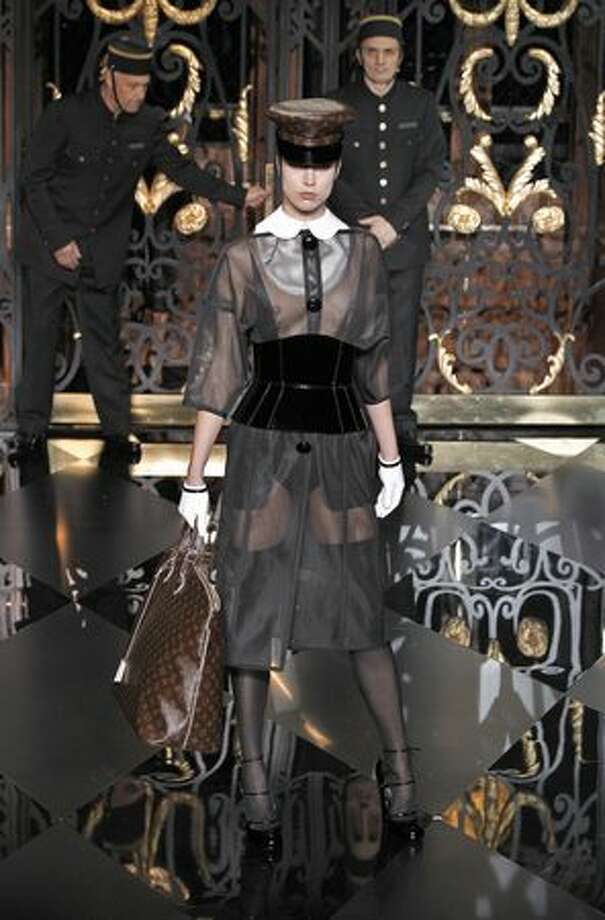A model presents a creation by Marc Jacobs for Louis Vuitton during the final day of Paris Fashion Week autumn/winter 2011-12 ready-to-wear collection shows on Wednesday, March 9, 2011. Photo: Getty Images / Getty Images