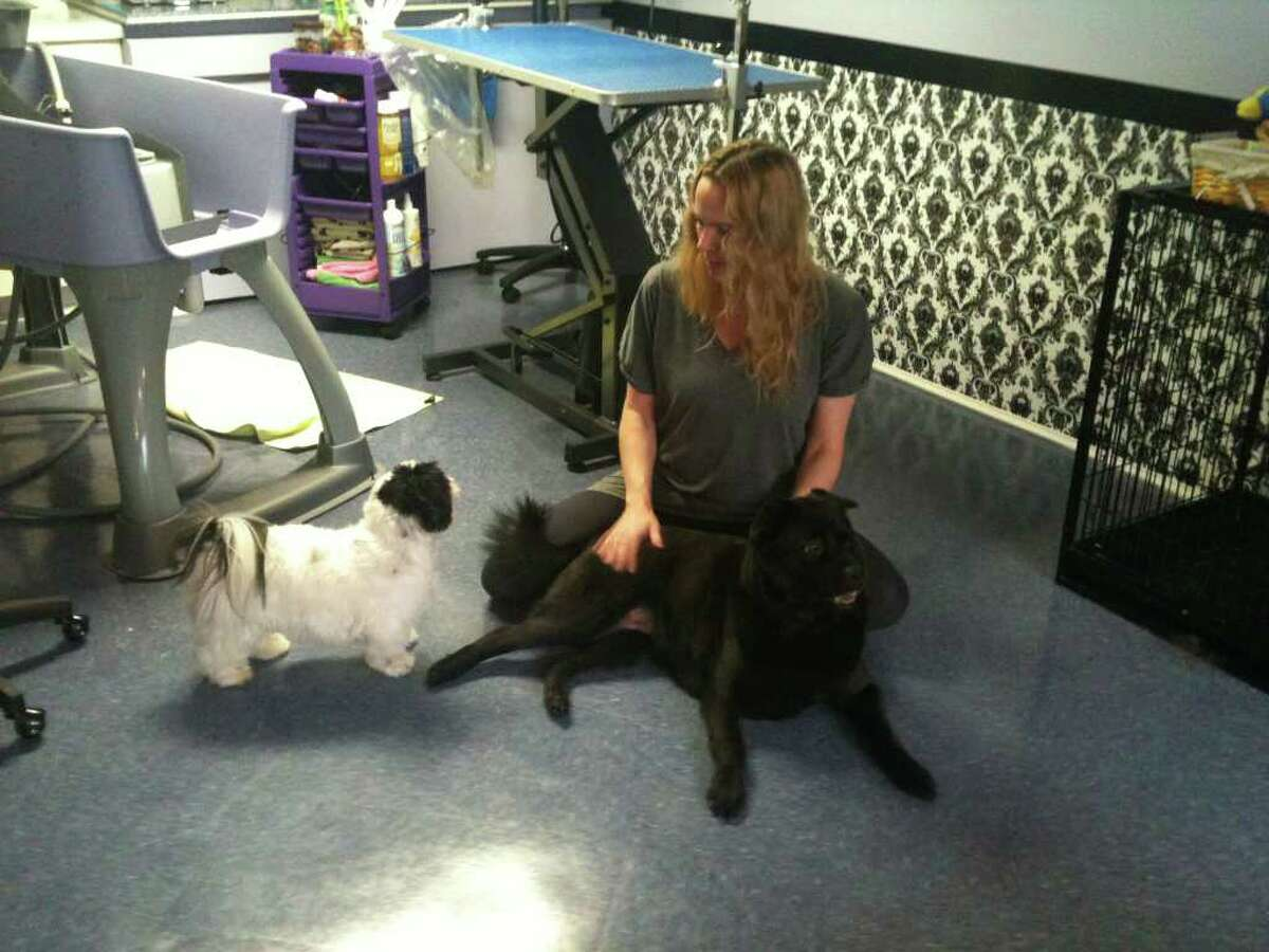 Lydia Foti makes sure dogs receive special treatment and grooming services in a tranquil setting. Her Sherman business, Lucky Pup Salon, is located in her home.