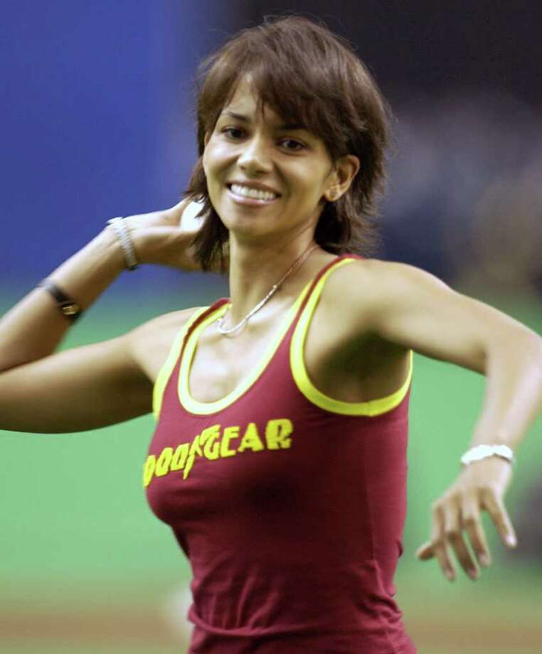 American actress Halle Berry  throws out the first pitch before the Log Angeles Dodgers and Montreal Expos game in Montreal, Sunday, May 11, 2003. (AP Photo/Andre Pichette) Photo: ANDRE PICHETTE, Associated Press / www.andrepichette.com