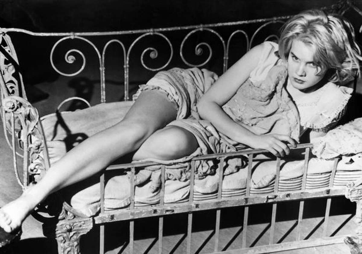 Carroll Baker (1931 - ), one in a long line of sultry blondes hoping to capitalize on the popularity of the type made famous by Marilyn Monroe. Notable role in the decade: Baby Doll Meighan in