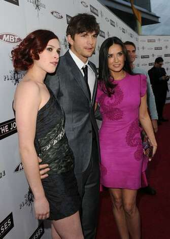 "Demi Moore (R) poses with Ashton Kutcher and her daughter Rumer Willis at the 2010 premiere of ""The Joneses.""  Photo: Getty Images"
