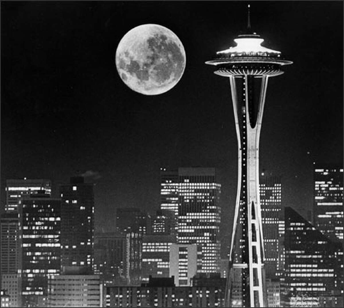 A full moon appears to hover next to the Space Needle in this composite photograph.