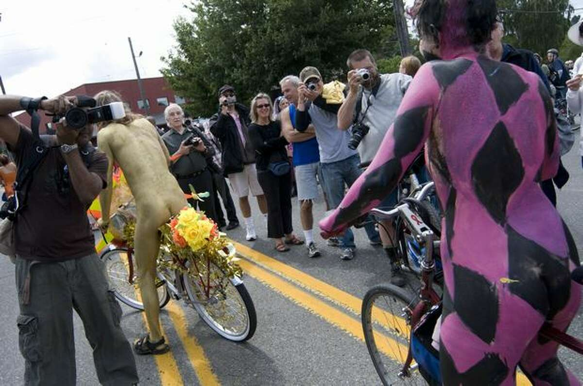 The world-famous naked bicyclists get ready to ride.