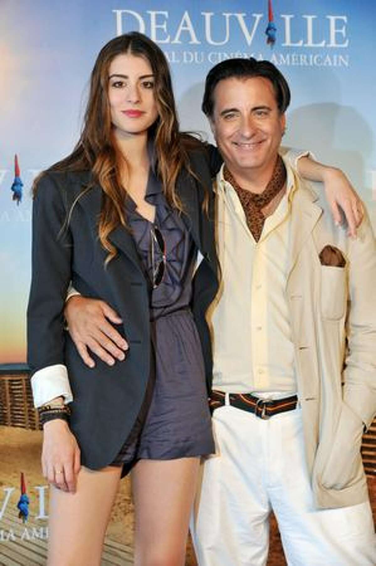Actress Dominik Garcia-Lorido poses with her father Andy Garcia at a photocall for the film